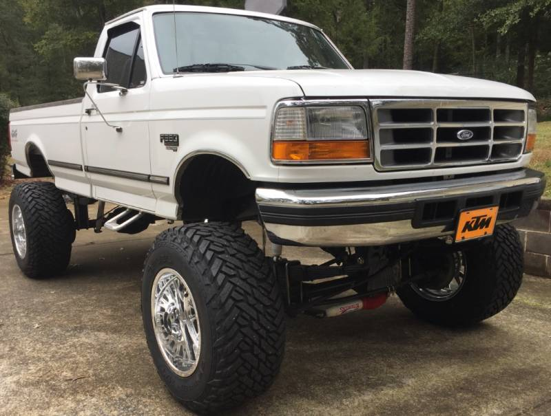"1996 Ford F350 with 9"" Lift on 38x15.50R20 Fuel Gripper Tires and 20x14 Moto Metal MO401 Pollished Forged Wheels"